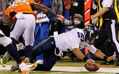 Super Bowl XLVIII - Russell Wilson is stopped short of a first down. He only ran the ball three times, finishing with 26 yards.  Read More: http://sportsillustrated.cnn.com/nfl/photos/1402/si-best-photos-from-super-bowl-xlviii//14/#ixzz2sJhpzvSV