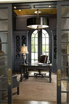 Studious looking office desk with dark walls! Plus, have a look at that ceiling detail! Oh my!  #homeoffice #darkwalls #ceiling