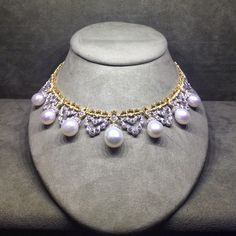 BUCCELLATI This spectacular necklace with 7 large pear-shaped salt water pearls draped from an 18k yellow and wh...