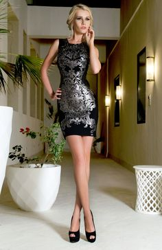 A stunning short cocktail dress with silver leather-like print, shining rhinestones and a stunning bandage style fit.