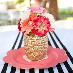 Because all weddings should have gold pineapple vases.