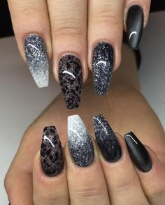 This glittering manicure is so fabulous, it's not even funny. Each nail is totally different, and they're all totally fabulous.