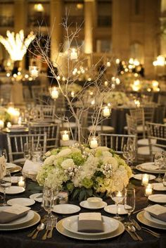 green-white-silver-branch-centerpiece? Skip the branches, add a clock or top hat