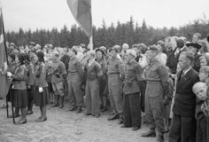 Guard of honour provided by members of the Royal Air Force Regiment and men of the local Danish Resistance at the ceremony in a forest clearing at Maarum, north of Copenhagen, to unveil a memorial to Flight Lieutenant R H Thomas and Flying Officer G J Allin who died when their Mosquito aircraft crashed at the site in September 1944.