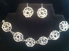 Silver Web bracelet and earring set.  Check it out at www.thefunkydingo.com