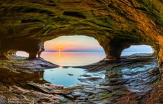 Sunset Sea Cave - The setting sun is reflected upon the chilly waters of Lake Superior as viewed from a secluded sea cave on the north Michigan coast. Thank for liking and sharing Kenneth Keifer Photography on FB!