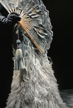 Gaultier.  Instead of ostrich feathers, I would love to see the new fabrics that have silky thread imitating feathers (ostrich feathers aren't cruelty free)