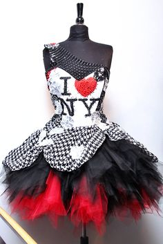 The I Luv NY tutu is made of patches of sequinned fabrics, and hand beaded with Swarovski crystals and crystallized sequinned flowers. The red and black tulle skirt has a draped houndstooth chiffon overskirt. Dress by Jaesyn Burke. Etsy.com/ jaesyn burke