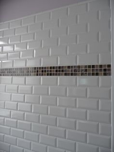 White subway tile with mosaic glass band accent