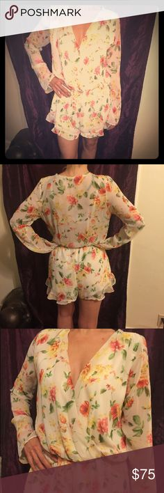 Spring Floral Onsy w/ VNeck. Long Ruffled Sleeves. This shorts, long sleeved cream colored onesie. The long sleeves have a ruffled edges along with the bottom of the shorts. The top is a Vneck cross body and an elastic waist band. Great for talk or girls or large breasts! Free People Other
