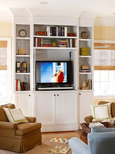 A ceiling-high bookshelf flanked by windows gives this media center a simple design, yet allows it to be the focal point of the room. Open shelving on the sides and top is perfect for display and decor, while the cabinets provide hidden space for media equipment. The molding on the top and edges of the unit adds detail and sophistication to the look.