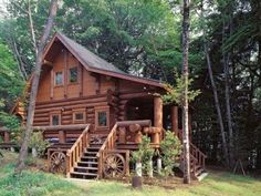 The small log cabin that follows is from Big Foot Log & Timber Homes, based in British Columbia, Canada. A charming architectural gem, it features a wraparound porch with large log railings.