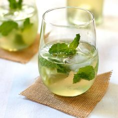 """If you're looking for something that's a little less boozy, give your guests this white wine mojito to try. Combine the lime, mint, and agave in a glass and muddle with a spoon. Add in the wine, club soda, and ice. Stir everything together, serve, and prepare for a chorus of """"ahs"""" as the refreshing beverage indulges your friends' taste buds. (Get the full recipe from Turnip the Oven)Ingredients:2 lime wedges6 fresh mint leaves1 teaspoon agave1/2 cup chilled white wine1/4 cup chilled club…"""