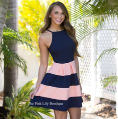 This dress is just what it says... easy on the eyes! This striped halter style dress has a cute peephole in the back with a button at the top, an elastic band around the waist, a flared skirt, and super soft fabric to make it easy to wear all day long. You can't go wrong with this adorable color combination of peach and navy, too!