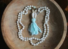 The original Shell mala! The Washed ashore mala is the ultimate endless summer piece, with Stunning white shell, Pearls, Smoky Quartz & Jade beads