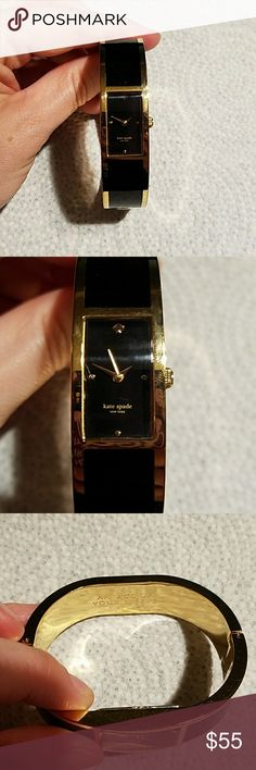 """Kate Spade bangle watch Very cute kate spade bangle watch in black and gold. The inside says """"an ace up your sleeve"""". It has minor wear from wearing it, the battery works and is ready for a new home! kate spade Jewelry"""