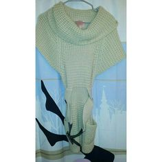💕Romeo & Juliet Couture sweater This is a Lovely R&J Couture beige sweater with droop neckline, two side pockets and a sexy black belt. Worn twice. Interested?  Blessings K~ Romeo & Juliet Couture Sweaters