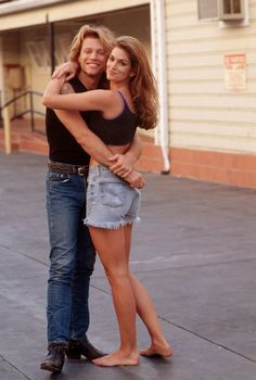 September 17, 1994  Where: With Jon Bon Jovi during a video shoot in Los Angeles, California.    Photo:  Neal Preston/CORBIS