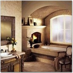 A romantic bathroom is created by putting a fireplace right next to the tub.