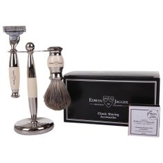 EDWIN JAGGER 3 PIECE SHAVING SET  This luxurious shaving set from Edwin Jagger comprises of an imatation ebony and nickel plated Gillette Mach3 razor, pure badger shaving brush and matching stand. Consequently, when the shaving brush is combined with hot water and quality Edwin Jagger shaving cream or soap, the lathering process introduces air and creates a warm, rich creamy lather that cleanses the skin, lifts the beard hairs and lubricates the path of the razor.   ThePlunge.com