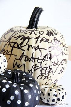 Painted pumpkins withs dots and words on them