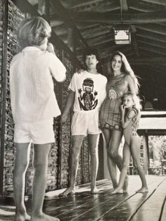 Jerry and Mick in Mustique with their two older children Elizabeth and James.