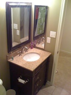Guest Bathroom COMPLETED!!!, I replaced the linoleum floor with some tile, took out the builders 36inch vanity with the white marble top and sink and replaced it with a 30 inch granite vanity.  Also replaced the shower rod with a rounded rod to add some space in the shower. Oh and painted the walls. What ya think of my work???, Added new vanity with granite top and faucet.  Also put in new framed mirror that i picked up from Michael's for $39.99  , Bathrooms Design