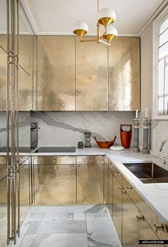 gold / silver kitchen.  apartment living.  decorating small spaces.  home decor and interior decorating ideas.