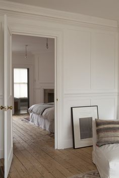 wood floors & white paneled walls