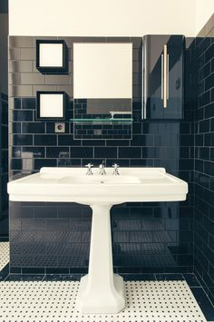 Retro Black and white bathroom design with extra largee vintage sink - Art Deco inspired designs of the Hotel Saint Marc luxury boutique hotel in central Paris, France. Retro Interior Design inspiration and images from the hotel featured on the Martyn White Designs Blog
