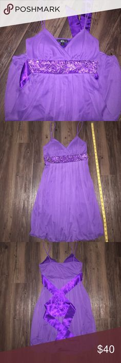 """Purple Strap Cocktail Dress 💜 Purple Strap Cocktail Dress with Sequin Beaded Band under bust. Built in Padding for bust with Silk bow tie in back to tie. Used once. Size Small. Length 33"""" inches long strap to end. Very elegant with beautiful simplicity 💟 Bundle with another item in my closet and save $$$ ☺ Make an offer, very negotiable price 💗 PERFECT FOR UPCOMING PROM OR SPECIAL EVENTS SEASON BCX Dresses Prom"""