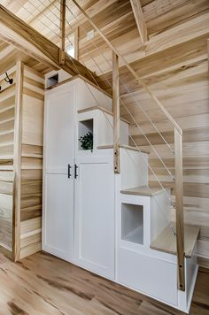 The Hatteras THOW by Modern Tiny Living 0022 This is the Hatteras Tiny House on Wheels by Modern Tiny Living. Hatteras is a stunning 20 ft. tiny house on wheels based upon Modern Tiny Living's popular Point design. Modern Tiny House, Tiny House Living, Tiny House Design, Tiny House Stairs, Loft Stairs, Tiny House Closet, Tiny House Trailer, Tiny House On Wheels, Living Room Remodel