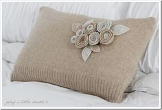 Old wool sweater turned into a pillow.  Adorable!