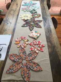 Blossoms Table Runner Paper Pattern – Free Bird Quilting Designs Evil eye beads, that will be one of many … Table Runner Size, Table Runner And Placemats, Table Runner Pattern, Quilted Table Runners, Quilt Pattern, Pattern Paper, Free Pattern, Pattern Sewing, Hand Quilting Designs