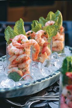 Shrimp Shooters | Dips and bite-sized treats can taste good and be good for you. Try one of these recipes for your next party or get-together. Appetizers are often just that: extremely tasty, often very rich and caloric, appetizing preludes to a larger meal. But today, with the popularity of the cocktail supper and brunch growing, often, we find ourselves offering a menu that may be entirely appetizers. What is someone who is trying to eat healthily do? Healthy party snacks! While yes, we do