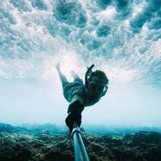 Photo of the Day: Where the # slows down. Poised above the #reef, @clay_kruse glides beneath the thundering #swell of the #Pacific. • • • #GoPro #GetOutside #Underwater #Snorkeling #Selfie