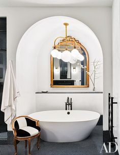 Naomi Watts and Liev Schreiber's Stunning New York City Apartment. A Ralph Lauren Home light fixture illuminates the master bath's Victoria + Albert tub, which has Dornbracht fittings; the mirror and chair are antique, and the penny tile is by Waterworks. Naomi Watts, Home Interior, Bathroom Interior, White Bathroom, Modern Bathroom, Bathroom Furniture, Modern Interior, Modern Luxury, Small Bathroom