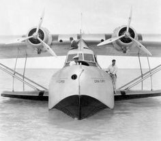 〰Pan American's China Clipper docking at Midway Island, 1937.