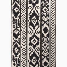 Handmade Tribal Pattern Ivory/ Black Wool Rug (5 x 8)