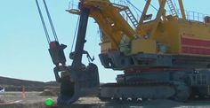 Bored miners play bowling with a huge mechanical excavator