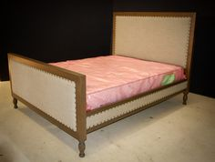 Custom-made bed with upholstered panels