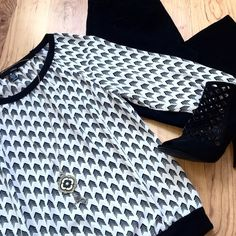 Aqua Arrrows Top Black and white pattern. Light fabric, three quarter sleeve. Back stretchy band around bottom and arms. Aqua Tops Blouses