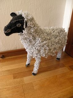 African Beaded Wire Animal Sculpture - SHEEP - White w/ Black Head by Hadeda on Etsy https://www.etsy.com/listing/203487938/african-beaded-wire-animal-sculpture