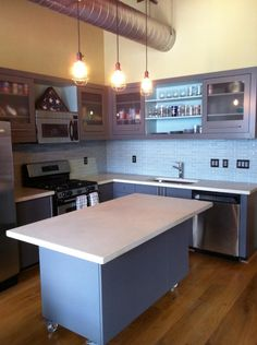 Open layout with island is the perfect kitchen for entertaining (Cultivate.com)