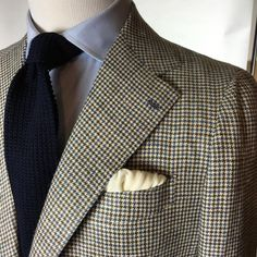 Houndstooth jacket, light blue shirt, navy knit tie