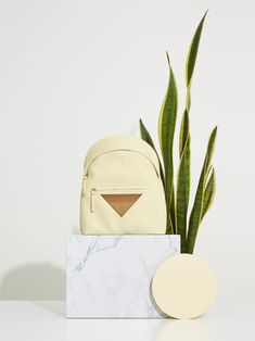 Iroko Weekend Backpack by Bakari.  Medium backpack made in calf leather and the inside in peccary leather. Zip closure. Decorated with a triangular piece of Iroko FSC Wood (sustainable forestry). Outer pocket with zip closure. Removable inner pouch with zip fastener. Handmade in Spain. Sustainable Forestry, Spring Summer 2016, Calf Leather, Calves, Spain, Backpack, Pouch, Closure, Pocket
