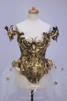 Golden corset. I like the idea of extra tulle on the hips. NO INFORMATION. IF ANYONE KNOWS ANYTHING?