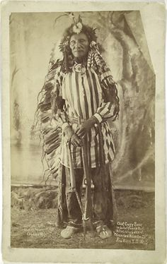 Rare full length portrait of Crazy Bear wearing Ghost Dance Suit. c. 1891 at Pine Ridge, S.D.