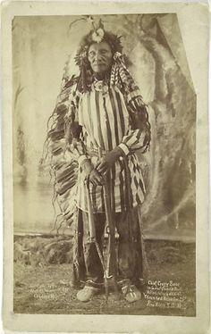 Rare full length portrait of Crazy Bear wearing Ghost Dance Suit. c. 1891 at Pine Ridge, S.D.