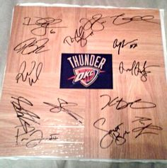 Oklahoma City Thunder 2013-14 Team Autographed Floor Tile. This simulated Floor Tile has been personally hand signed by Head Coach: Scott Brooks, Andre Roberson, Derek Fisher, Hasheem Thabeet, Jeremy Lamb, Kendrick Perkins, Kevin Durant, Nick Collison, Perry Jones, Reggie Jackson, Russell Westbrook, Serge Ibaka, Steven Adams, and Thabo Sefolosha. The hand signed signatures on this autographed basketball photo have been obtained in person and witnessed by a Score Memorabilia authorized agent.